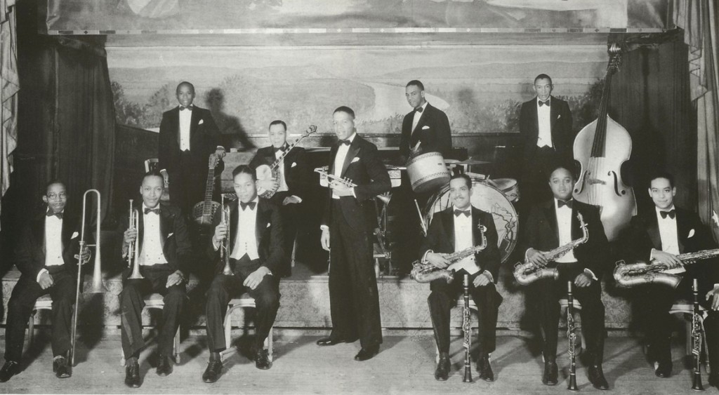 Henry 'Red' Allen fronting Luis Russell's Orchestra. L-R Jimmy Archey, Bill Coleman, Luis Russell, Bill Dillard, Will Johnson, Henry 'Red' Allen, Paul...